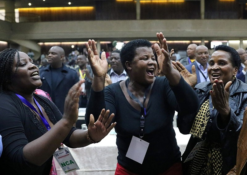 Delegates celebrate after Zimbabwean President Robert Mugabe was dismissed as party leader at an extraordinary meeting of the ruling ZANU-PF's central committee in Harare, Zimbabwe November 19, 2017. (Reuters Photo)