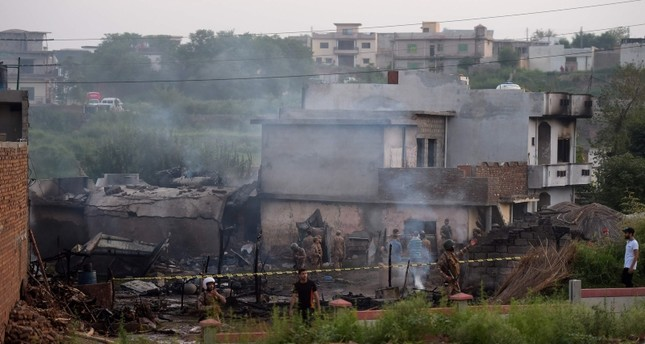 Soldiers cordon off the site where a Pakistani Army Aviation Corps aircraft crashed in Rawalpindi on July 30, 2019. (AFP Photo)