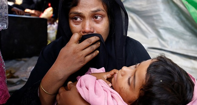 A Rohingya woman cries as the Member of Border Guard Bangladesh (BGB) restrict them from entering Bangladesh, in Cox's Bazar, Bangladesh, August 27, 2017. (Reuters Photo)