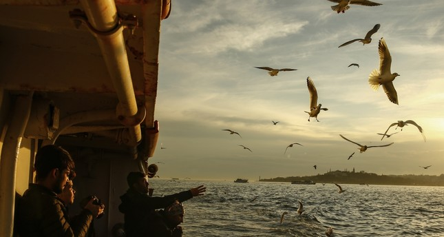 People enjoy the coming of spring with a ferry tour on the Bosporus.