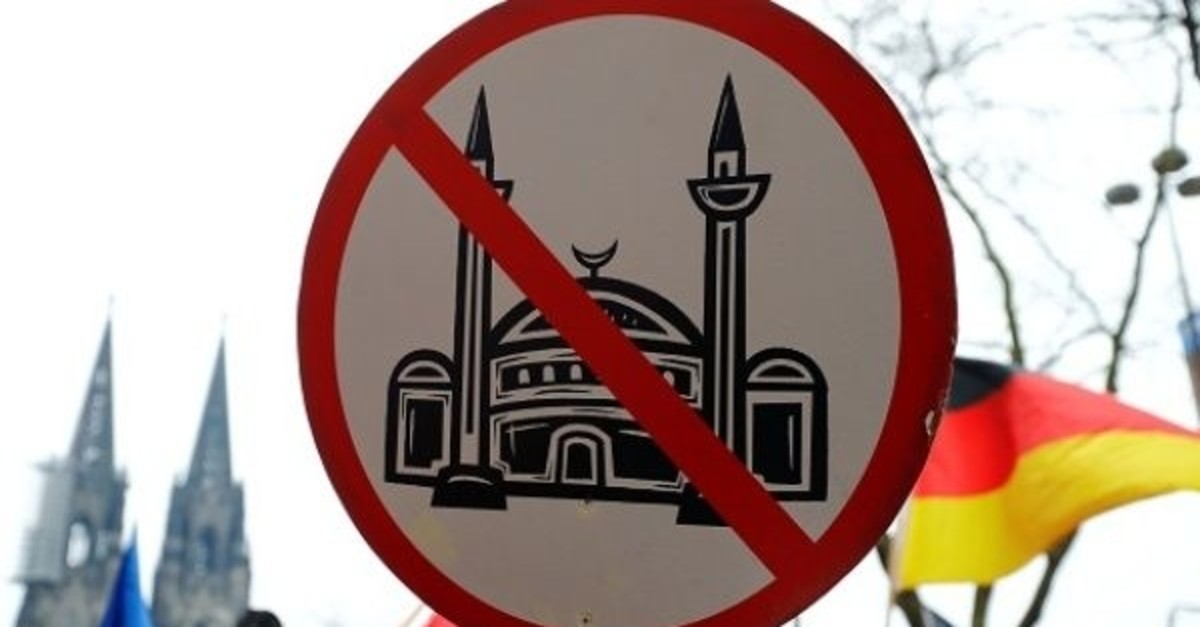 An ultra right-wing group gathers with a placard against mosques in Cologne, Germany on Jan. 7, 2017 (Reuters Photo)