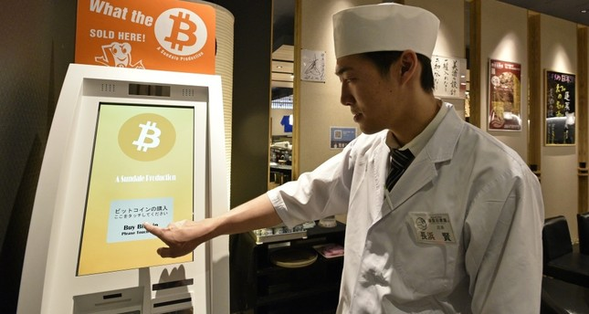 Ken Nagahama, Numazuko Ginza sushi restaurant manager, demonstrates the Bitcoin purchase system at his restaurant in central Tokyo.