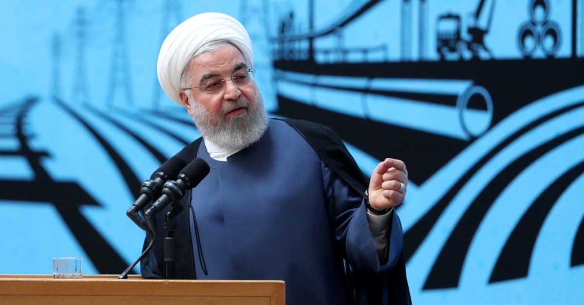In this photo released by the official website of the office of the Iranian Presidency, President Hassan Rouhani speaks in a conference in Tehran, Iran, Monday, Aug. 26, 2019. (Iranian Presidency Office via AP)