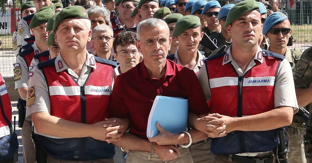 Soldiers escort Mehmet Diu015fli, the putschist general who was behind army chief Hulusi Akaru2019s abduction during the 2016 coup attempt, to a courtroom for a hearing in 2017.
