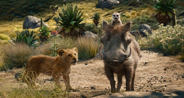 This file image released by Disney shows, from left, young Simba, voiced by JD McCrary, Timon, voiced by Billy Eichner, and Pumbaa, voiced by Seth Rogen, in a scene from The Lion King. (AP Photo)