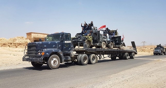 A handout picture released by Iraqi Federal Police on August 15, 2017, shows Iraqi armoured units headed for the town of Tal Afar, the main remaining Daesh terrorist group stronghold in the northern part of the country. (Iraqi Federal Police via AFP)