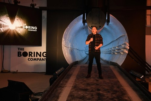 Elon Musk, co-founder and chief executive officer of Tesla Inc., speaks during an unveiling event for the Boring Company Hawthorne test tunnel in Hawthorne, south of Los Angeles, California on December 18, 2018. (AFP Photo)