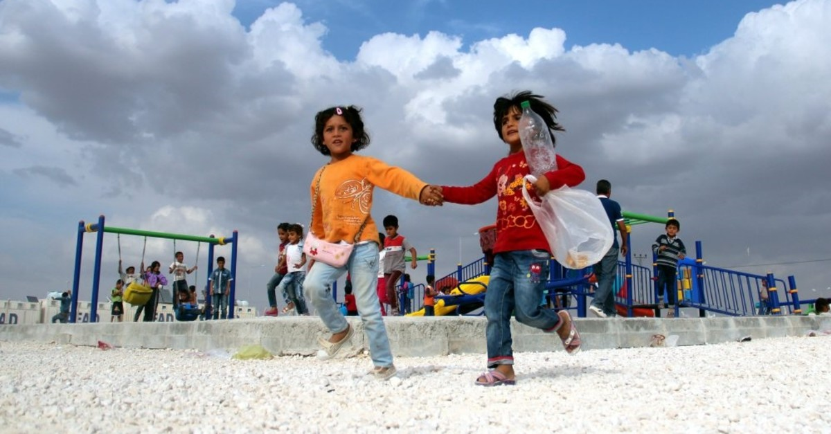 Children play with their new toys at a refugee camp in u015eanlu0131urfa.
