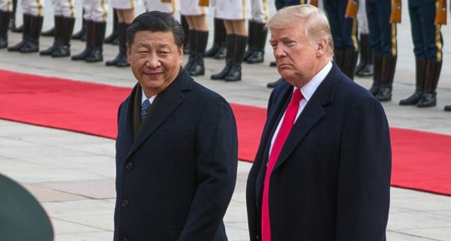 U.S. President Donald J. Trump (R) and Chinese President Xi Jinping (L) review soldiers of the Chinese People's Liberation Army honor guard during a welcome ceremony at the Great Hall of the People in Beijing, China, Nov. 09, 2017. (EPA Photo)