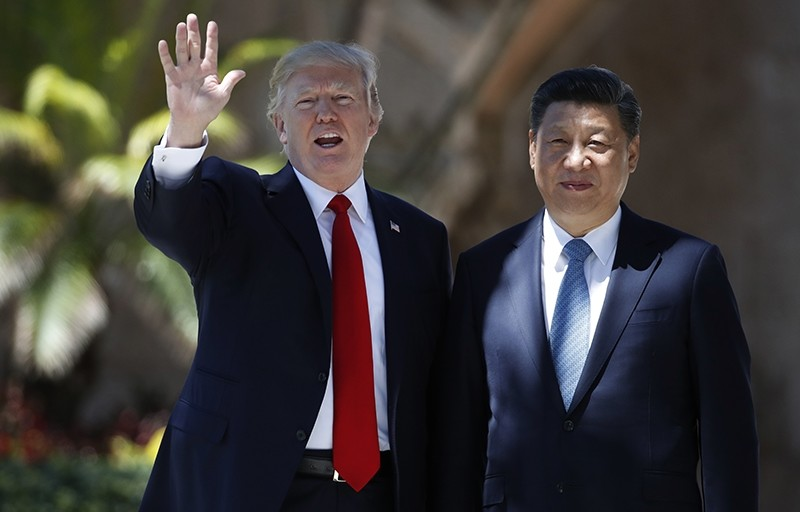 In this Friday, April 7, 2017 file photo, President Donald Trump and Chinese President Xi Jinping pause for photographs at Mar-a-Lago in Palm Beach (AP Photo)