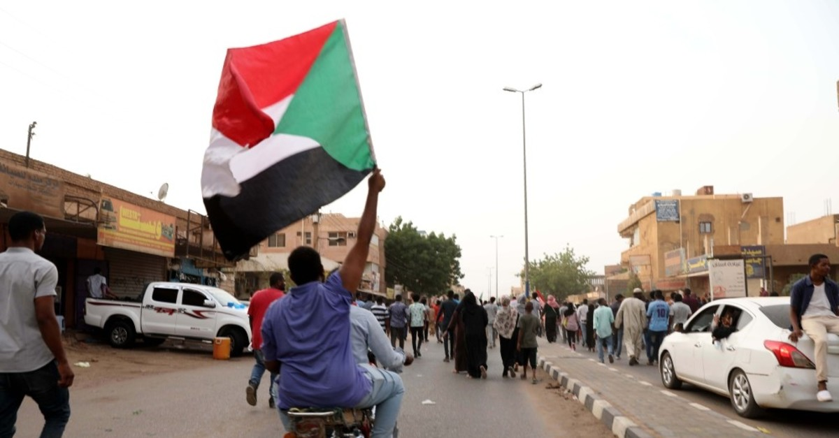 Sudanese protesters shout slogans during a protest against the ruling military council in Khartoum, June 30, 2019.