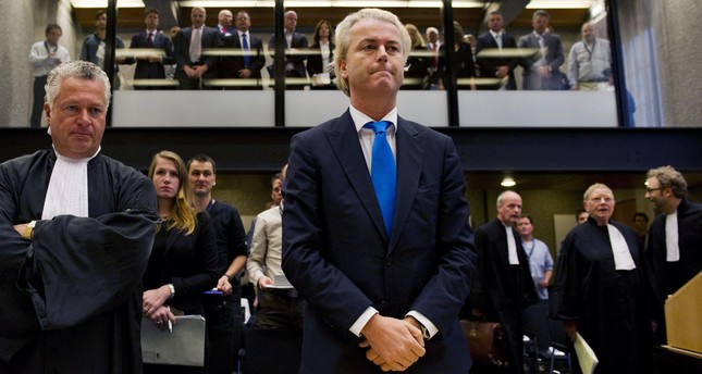 Dutch anti-Islam, far-right politician Geert Wilders (C) waits for the start of his trial at a court, Amsterdam, the Netherlands, Oct. 4, 2010.