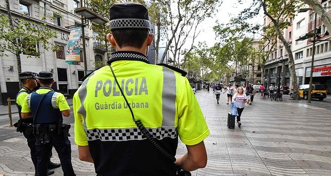Police officers stand guard on the Las Ramblas boulevard in Barcelona on August 19, 2017, two days after a van ploughed into the crowd (AFP Photo)