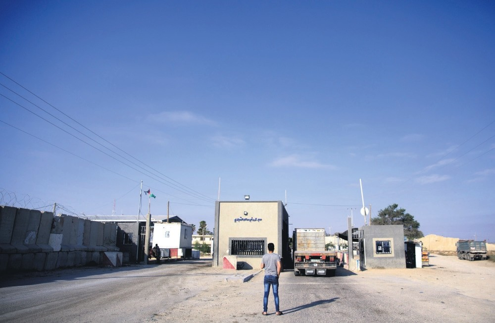 A man stands on the Palestinian side of the Israeli Kerem Shalom cargo crossing near Rafah in the southern Gaza Strip, July 10.