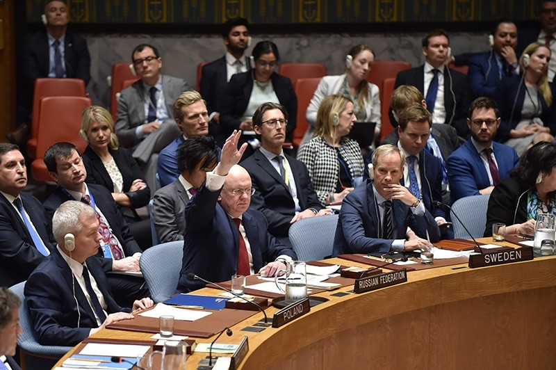 Russian Ambassador to the UN Vasily Nebenzya votes during a UN Security Council meeting at the United Nations Headquarters in New York, on April 14, 2018. (AFP Photo)