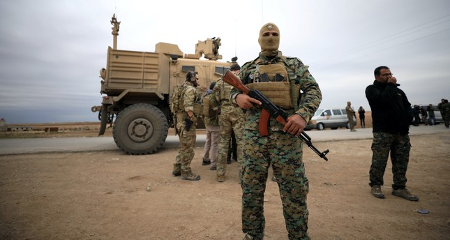 YPG and U.S. troops seen during a patrol near the Turkish border in Hasakah, Syria, Nov. 4, 2018.