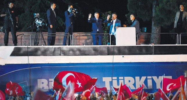 President Erdoğan (C) waves to supporters celebrating the election results, Istanbul, Sunday.