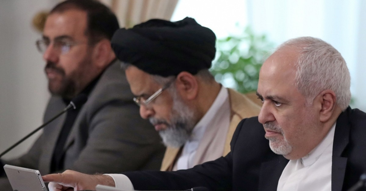 A handout picture provided by the Iranian presidency shows Iranian Foreign Minister Mohammad Javad Zarif (R) speaking during a cabinet meeting chaired by President Hassan Rouhani in the capital Tehran on September 18, 2019. (AFP Photo)