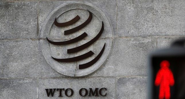 A logo is pictured outside the World Trade Organization (WTO) headquarters next to a red traffic light in Geneva, Switzerland, October 2, 2018. (Reuters Photo)