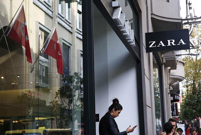 A shopper exits a fashion retailer Zara branch in an Istanbul upscale neighbourhood, Friday, Nov. 3, 2017. (AP Photo)