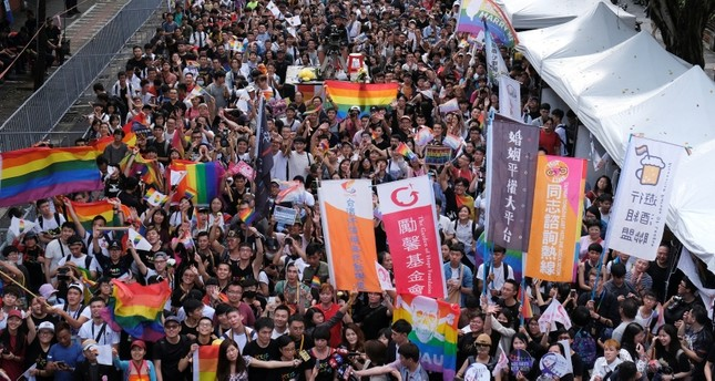 Same-sex marriage supporters celebrate after Taiwan became the first place in Asia to legalize same-sex marriage, outside the Legislative Yuan in Taipei, Taiwan May 17, 2019. Reuters Photo