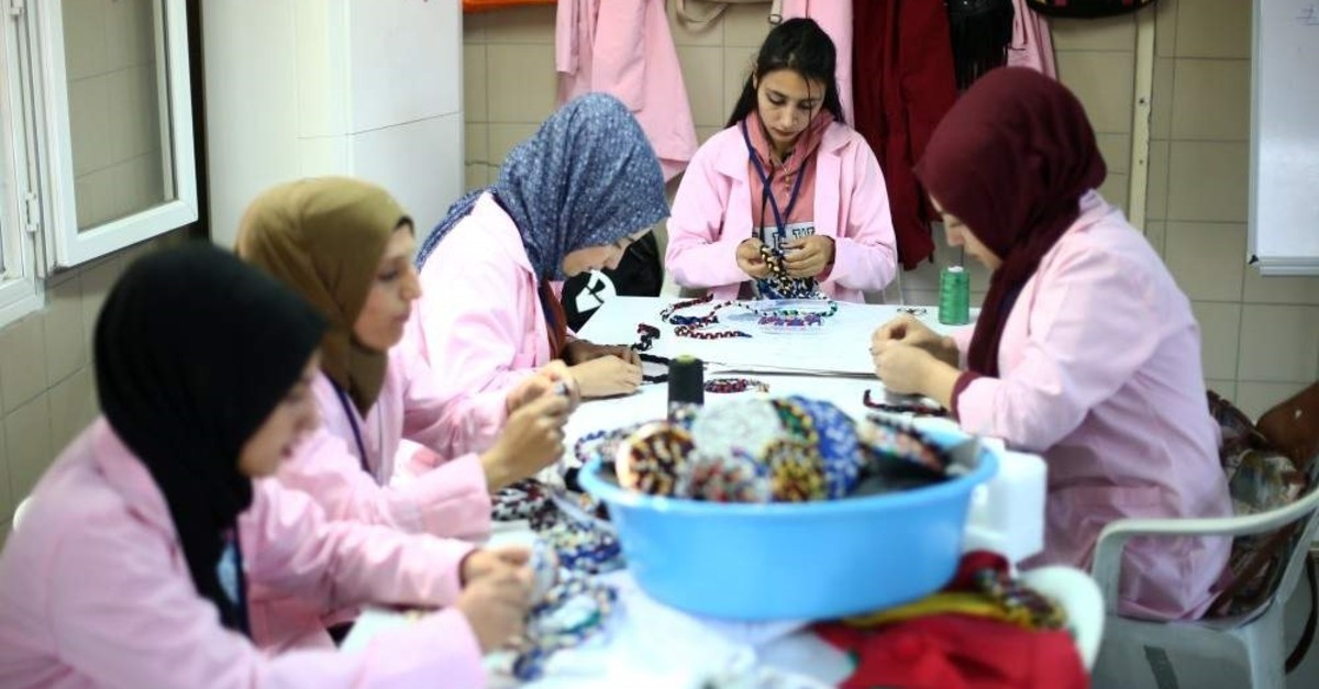 Syrian and Turkish women craft souvenirs in the cooperative. (AA Photo)