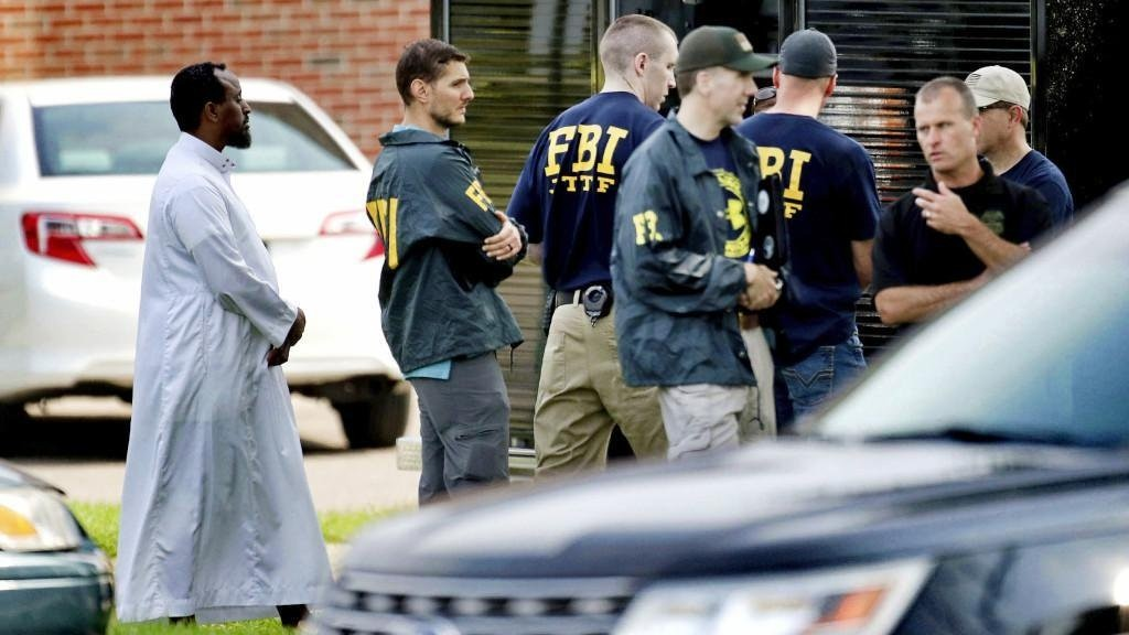 In this Aug. 15, 2017 file photo, Law enforcement officials investigate an explosion at the Dar Al-Farooq Islamic Center in Bloomington, Minn. (AP Photo)