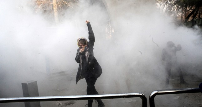Iranian students clash with riot police during an anti-government protest around the University of Tehran, Iran, 30 December 2017. (EPA Photo)