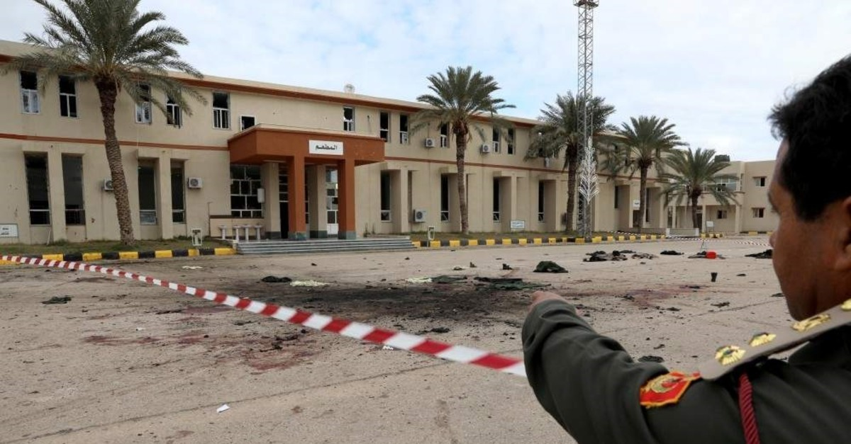 A member of security forces of the Government of National Accord (GNA) gestures as he inspects the site of an attack on a military academy in Tripoli, Libya Jan. 5, 2020. (Reuters Photo)
