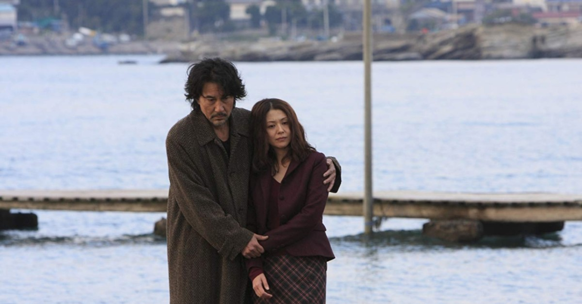 Koji Yakusho (L) and Kyoko Koizumi in Kurosawau2019s film u201cTokyo Sonatau201d (2008).