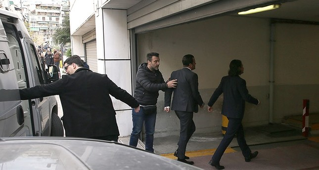 Greek police escorts putschist to hearing at the Athens Appeals Court on March 16, 2018. (AA Photo)