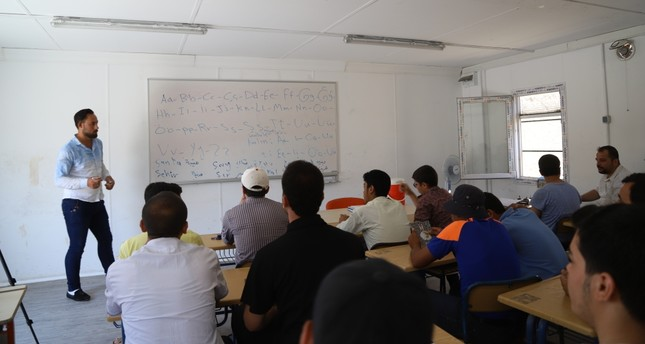 Syrians attend a Turkish language class in Mare, July 12, 2019.