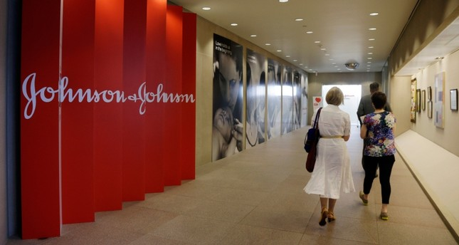 In this July 30, 2013, file photo, people walk along a corridor at the headquarters of Johnson & Johnson in New Brunswick, N.J. AP Photo
