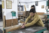 Turkish students build school desks for their peers in Syria