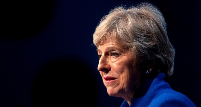 British Prime Minister Theresa May delivers a speech at the Zero Emission Vehicle Summit in Birmingham, Britain, 11 September 2018. (EPA Photo)