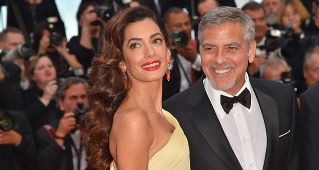 File photo dated May 12, 2016 shows US actor George Clooney (R) and his wife Amal Clooney at the 69th Cannes Film Festival in Cannes, southern France. (AFP Photo)