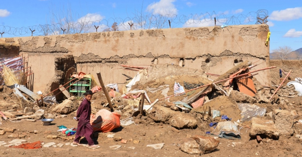 A boy walks inside what is left of a home that was damaged by heavy rains in Kandahar province, south of Kabul, Afghanistan, Sunday, March, 3, 2019. (AP Photo)