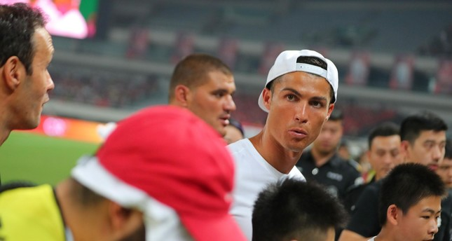 Real Madrid player Christiano Ronaldo attends an event as part of his individual promotional tour of China, in Shanghai on July 22, 2017. (AFP PHOTO)