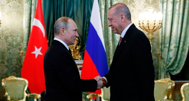 Russian President Vladimir Putin (L) shakes hands with President Recep Tayyip Erdoğan (R) ahead of a meeting at The Kremlin in Moscow on April 8, 2019. (AFP Photo)