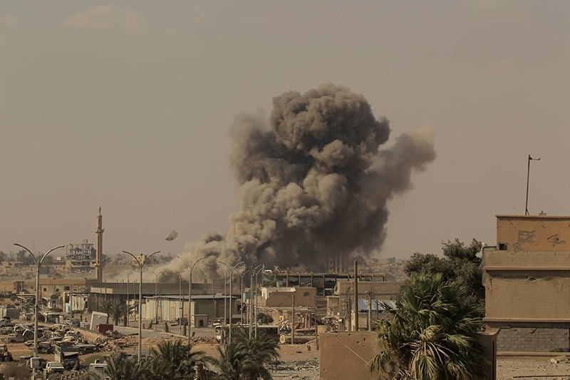 Smoke rises after an airstrike during fighting between U.S.-backed fighters and Daesh terrorists in Raqqa, Syria, August 15, 2017. (Reuters Photo)