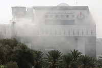 2 killed in attack on headquarters of Libyan state oil firm