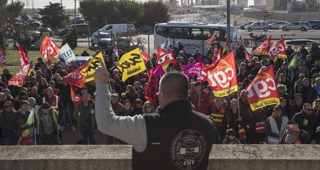 CGT union leader Olivier Mateu gives a speech to union members at a petrochemical factory where workers have been striking, Martigues, Dec. 14, 2019. AP Photo/Daniel Cole