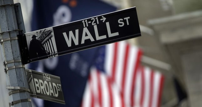 Wall Street closes with records after strong data