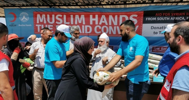 Charity officials delivered packages of rice to Syrian refugees in the southern province of Hatay, Aug. 8, 2019.