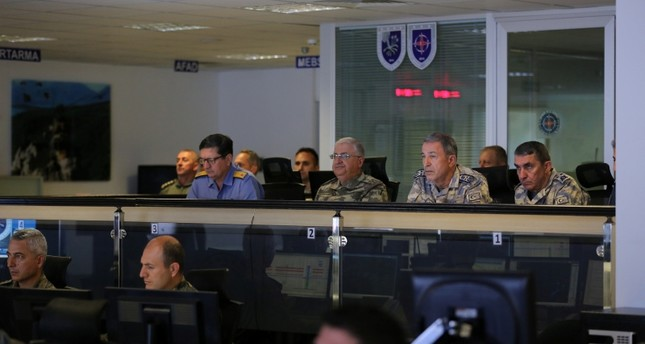 Turkish Chief of General Staff Gen. Hulusi Akar (2ndR) monitors Turkish airstrikes targeting PKK terrorists in northern Iraq's Qandil, Sinjar, Hakurk and Avashin-Basyan at the joint air operation center in Eskişehir, Turkey, June 12, 2018. (AA Photo)