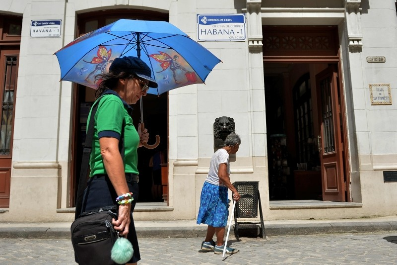 People pass by a post office in Havana after direct mail between Cuba and the U.S. was re-established at the end of a trial period despite a toughening stance by U.S. President Donald Trump toward the islandu2019s government, June 1.