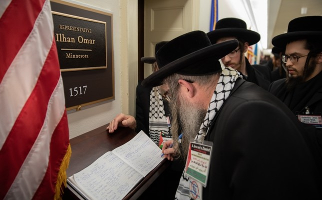 Orthodox Jews with the group Jews United Against Zionism gather outside the office of Rep. Ilhan Omar, D-Minn., in a show of support on Capitol Hill in Washington, Wednesday, March 6, 2019. (AA Photo)