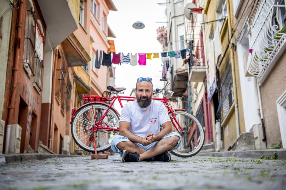 Yapar's red bike became more than a vehicle of transportation. For Yapar, it is a mean to help people in need.