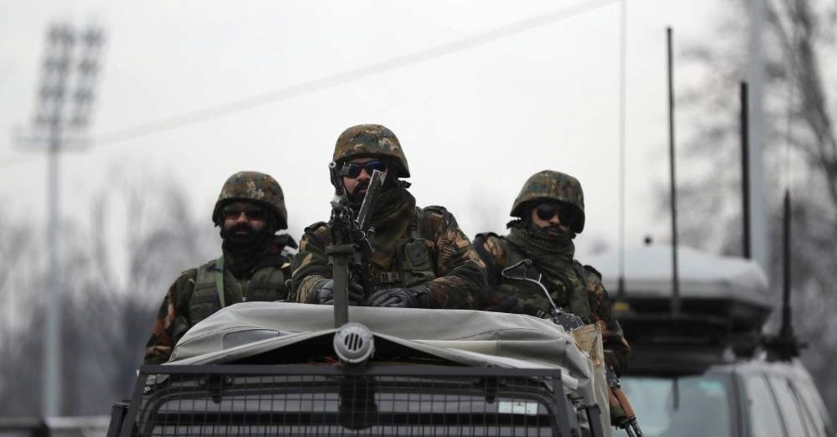 Indian army soldiers guard on top of their armored vehicle as a convoy of New Delhi-based diplomats passes through Srinagar, Indian controlled Kashmir, Thursday, Jan. 9, 2020. (AP Photo)