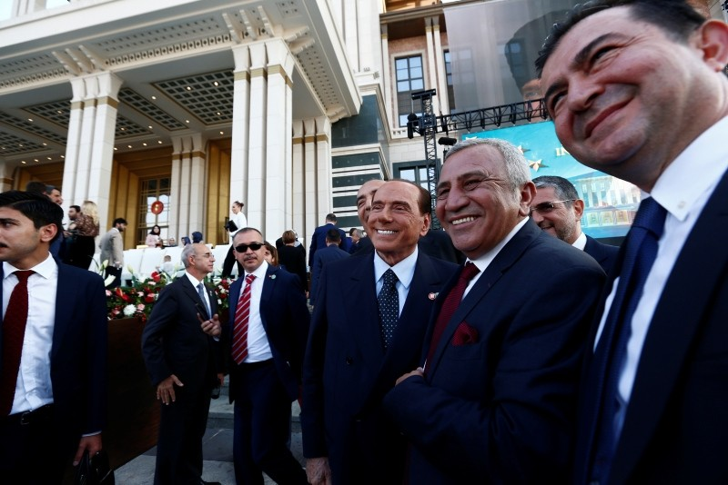 Former Italian Prime Minister Silvio Berlusconi, cente, poses for pictures with other attendees following a ceremony for Erdoğan, Monday, July 9, 2018.r